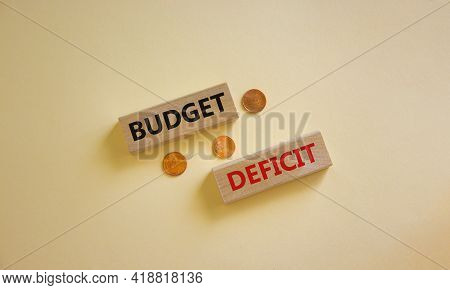Budget Deficit Symbol. Concept Words 'budget Deficit' On Blocks On A Beautiful White Background, Met