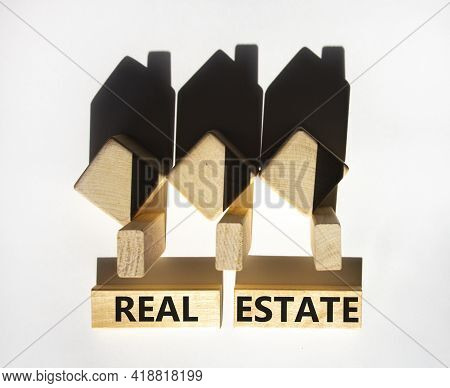 Real Estate Symbol. Wooden Blocks With Words 'real Estate'. Houses Created By Shadows From Wooden Cu