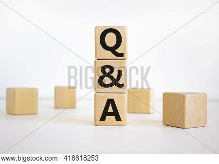 Questions And Answers Symbol. Word 'q And A, Questions And Answers' On Wooden Cubes On A Beautiful W