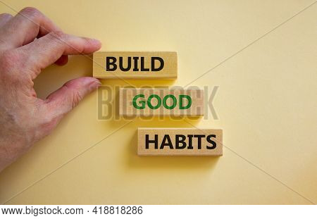 Build Good Habits Symbol. Wooden Blocks With Words 'build Good Habits'. Businessman Hand. Beautiful