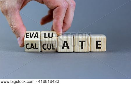 Calculate Or Evaluate Symbol. Businessman Turns Wooden Cubes And Changes The Word 'evaluate' To 'cal