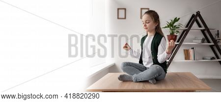 Meditation And Relaxation Of A Little Teen Sitting On A Desk In A Lotus Position With Her Legs Cross