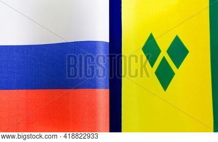 Fragments Of The National Flags Of Russia And Saint Vincent And The Grenadines Close-up