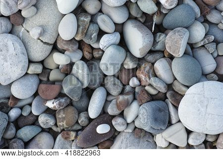 Pebbles On A Beach. Background. Sea Stone Background. Close Up.