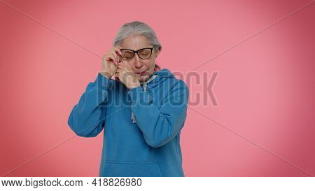 Upset Disappointed Senior Old Granny Gray-haired Woman Wipes Tears And Cries From Despair, Being Sad