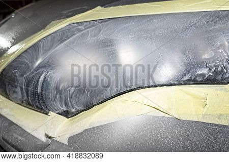 The Headlight Is Covered With Abrasive Paste And Secured With A Protective Tape, Prepared For Polish