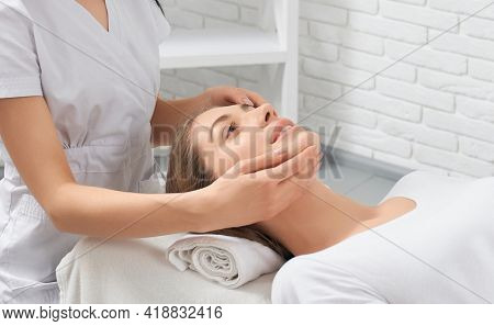 Side View Close Up Of Smiling Young Brunette Woman On Procedure Massage In Professional Beautician.