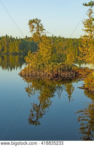 Morning Reflections On A Tiny Island On Jenny Lake In The Boundary Waters In Minnesota