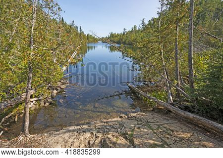 Narrow Lake Heading Into The Wilderness On The Kekekabec Ponds In The Boundary Waters In Minnesota