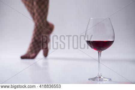 Sexy Legs Woman. Sensual. Red Wine Glass. Sensual.