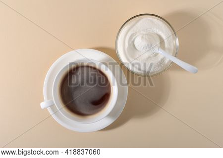 Collagen Powder And Cup Of Coffee On Beige Background. Extra Protein Intake. Natural Beauty And Heal