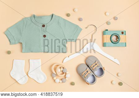 Gender Neutral Baby Garment, Toys And Accessories. Organic Cotton Clothes For Newborn