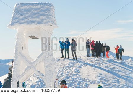 Kasprowy Wierch, Poland 28.01.2021 - A Group Of Mountaineers On A Snowy Mountain Peak. Closeup View