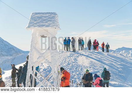 Kasprowy Wierch, Poland 28.01.2021 - A Group Of Hikers On A Snowy Mountain Peak. Closeup View Of A S