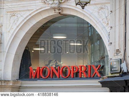 BAYONNE, FRANCE - CIRCA APRIL 2021: Red Monoprix sign outside supermarket.
