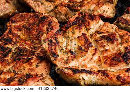 Close Up Of Pork Steak Grilled On A Charcoal Barbeque Isolated.