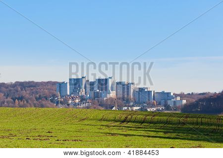 Urban high-rise apartment buildings on green field