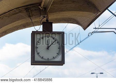 Closeup Of Analog Clock On The Train Station