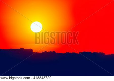 Silhouette Of The City At Sunset . Sundown Over The Big City