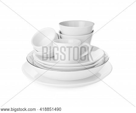 Stack Of Clean Dishware Isolated On White