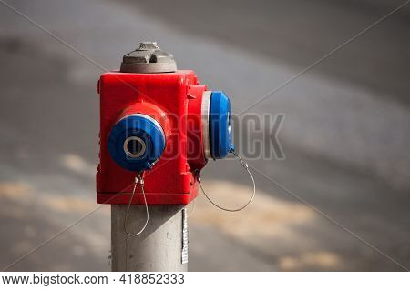 Selective Blur On A Red And Blue Fire Hydrant From The Serbian Firefighters, In A Street. It Is Used