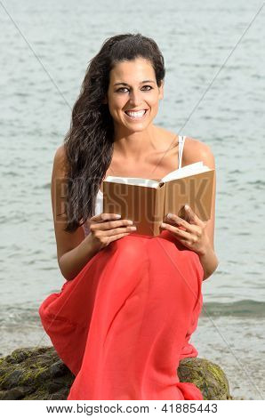 Woman Happy Reading Book Near The Sea