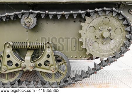 Tank Tracks. Tank Of The Second World War. Track Armor Close-up. Black Track Link And Large Rubberiz