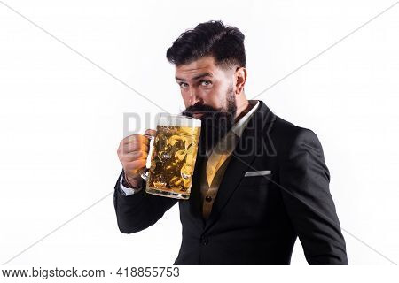 Portrait Of Handsome Bearded Man Tasting A Craft Beer. Stylish Handsome Man In Black Suit Drinking B