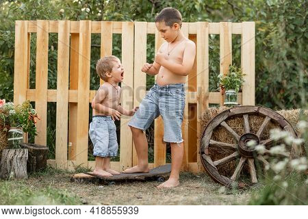 Older Sibling Brother Not Giving His Toy To Younger Brother. Kids Cannot Share Toys. Boys Fighting.
