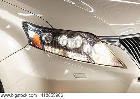 Novosibirsk, Russia - April 25 2021: Lexus Rx, Exterior Detail . Close Up  Of Modern  Car Xenon Lamp