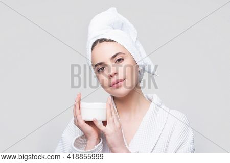 Face Beauty Care. Portrait Of Beautiful Woman With Facial Cream In Hand. Sexy Female With Fresh Clea