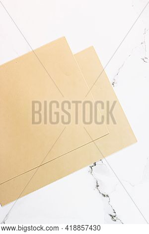 Beige A4 Papers On White Marble Background As Office Stationery Flatlay, Luxury Branding Flat Lay An