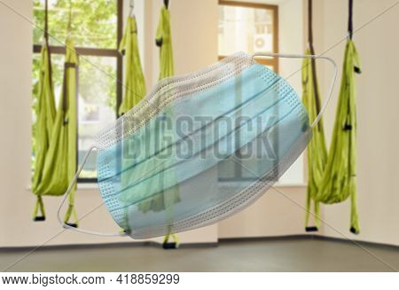Being Indoors Only In A Sanitary Mask, Fitness Club With Three Hammocks. Indoor Fitness Club