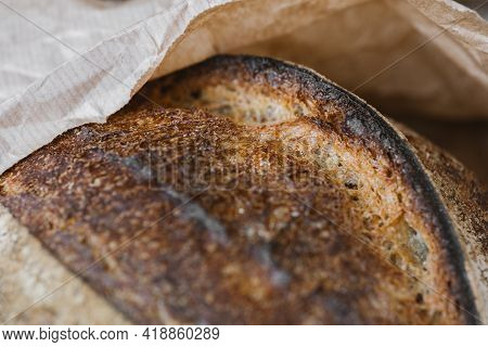 Beautiful Crispy Bread Close-up. Texture Surface Of Baked Bread Crust. Selective Focus.
