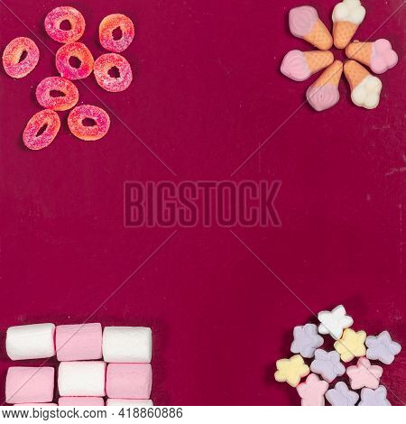 Flat Lay Composition With Different Yummy Candies And Space For Text On Color Background.