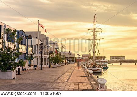 Port Adelaide, Australia - December 8, 2018: Port Adelaide Docks With Homes And Ships In Port River