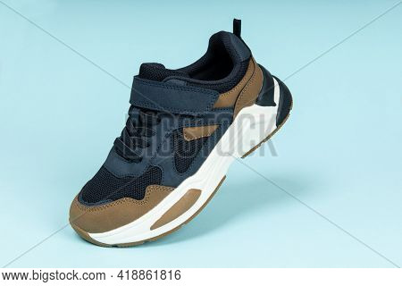Running Sports Shoe On Blue Background. Running Shoe, Sneaker Or Trainer. Athletic Shoe. Fitness, Sp