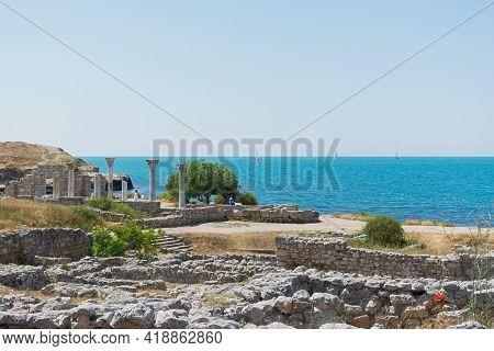 Sevastopol Crimea Chersonesos 09 June 2019. Ancient Byzantine Basilica On The Background Of The Turq