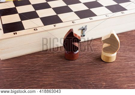 Educational Chess, White And Black Knight Pieces On A Chessboard, Selective Focus