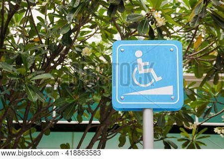Slope Way Sign For Wheelchair Disabled Person.