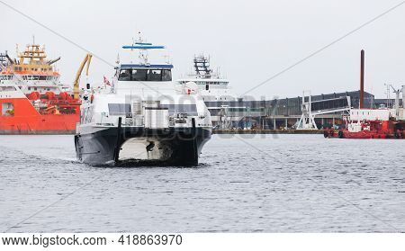Catamaran Fast Passenger Ferry Enters The Port Of Bergen, Norway