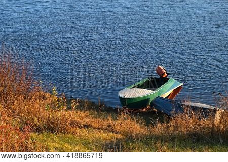 Different Old Boats Are On The Riverbank In Autumn Sunny Day In Village.