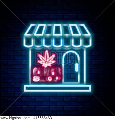 Glowing Neon Line Marijuana And Cannabis Store Icon Isolated On Brick Wall Background. Equipment And