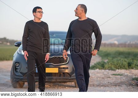 Teenager Boy With Father Outdoors. Happy Dad Teaching Teenage Son To Drive Permission To Drive, Pare