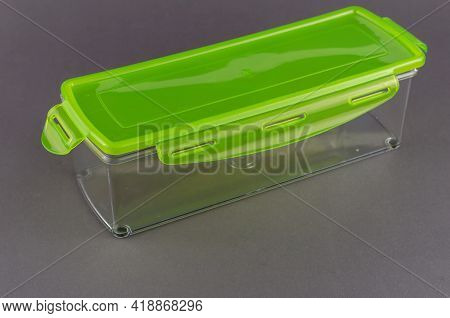 Rectangular Plastic Container With Lid For Food Storage On Gray Background. Transparent Box With Gre