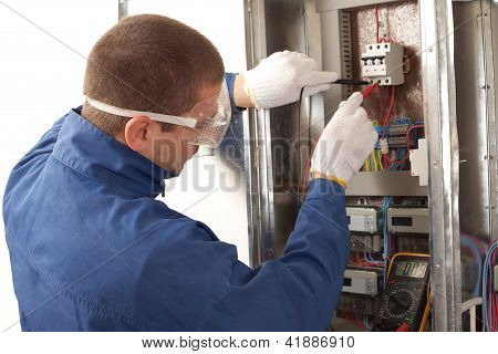 Electrician Checking The Energy Meter