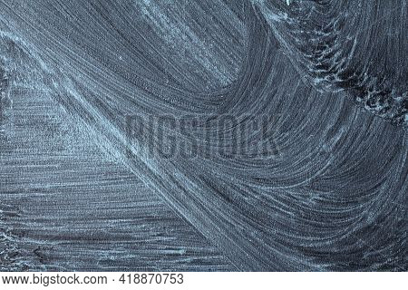 Textured Surface Of Black Chalk Board With Abstract Patterns And Traces Of Erased Chalk. Free Space