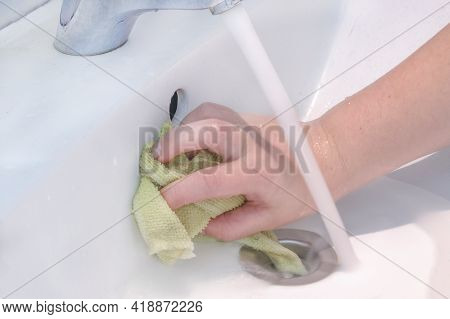 A Housewife With A Hand Without A Glove Conducts Daily Cleaning Of The Sink With Washing Powder And