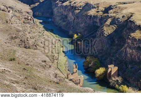 Ruins Of Ancient Bridge Crossing River Arpa In Medieval City Ani, Near Kars, Turkey. Bridge Located