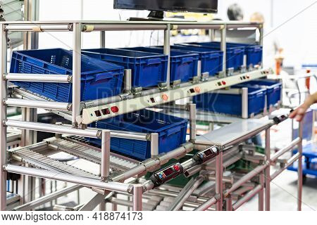 Basket Or Plastic Box Container On Roller Rack Or Aluminum Shelf With Electronic Display Smart Modul